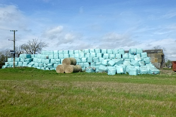 Unsuspecting farmers have been left with bales of landfill waste dumped on their land. Photograph: Environment Agency