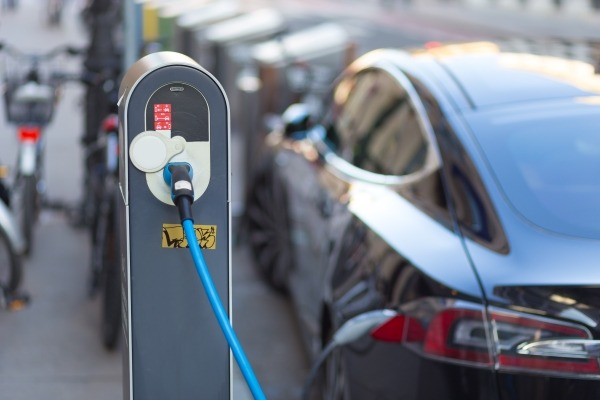 electric vehicles hooked up to charging points