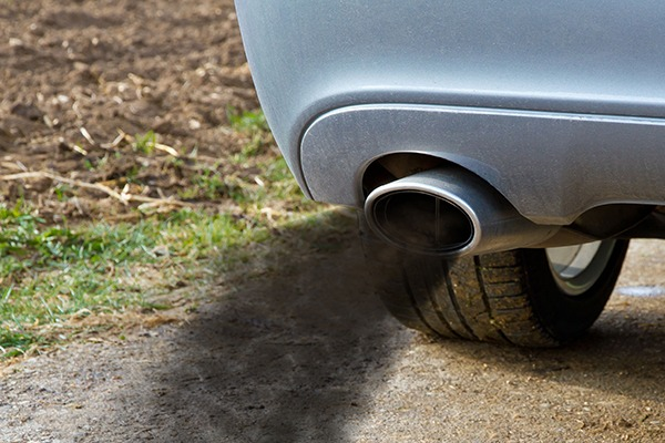 car belching diesel smoke and particulates