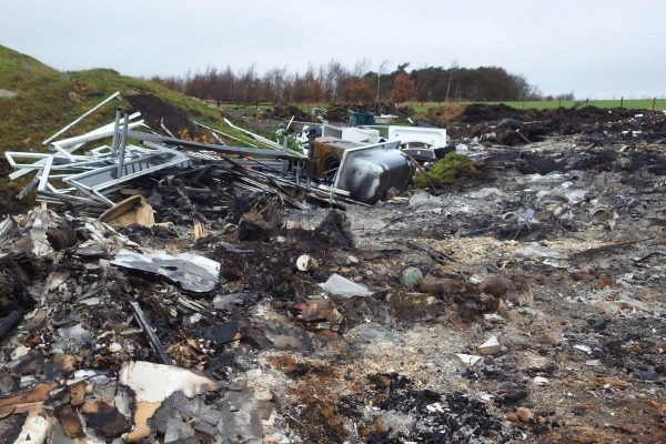 Pickering burnt waste including uPVC doors, window frames, wood and  wheelie bins. Photograph: Environment Agency