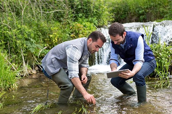 Men taking water samples from river. Photograph: Prig Morisse/123RF
