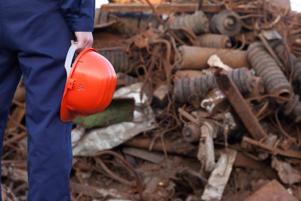 Builder holding helmet. Photograph: Shotsstudio/123RF