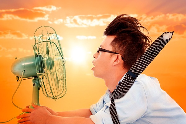 Man in front of fan. Photograph: Wang Tom/123RF