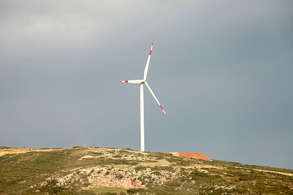 Wind turbine on a hill. Photograph: Şafak Cakır/123RF