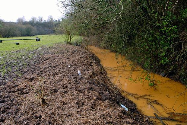 Polluted stream on top of an old landfill site. Photograph: Jeff Morgan/Alamy Stock Photo
