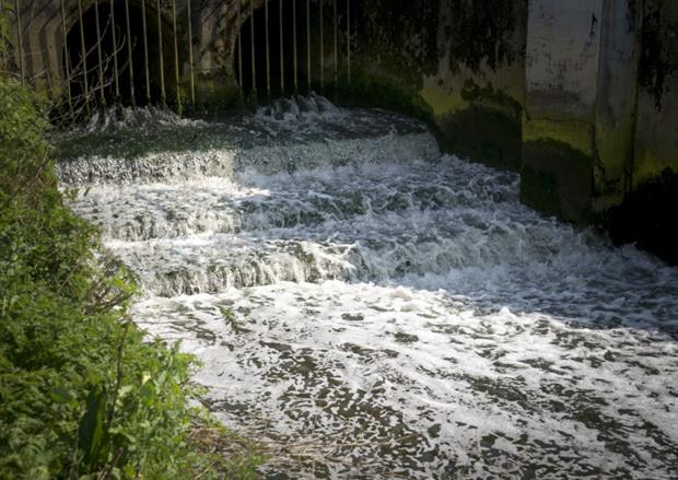 Wastewater entering a river from a CSO. Photograph: Robert Brookl/Science Photo Library/Getty Images