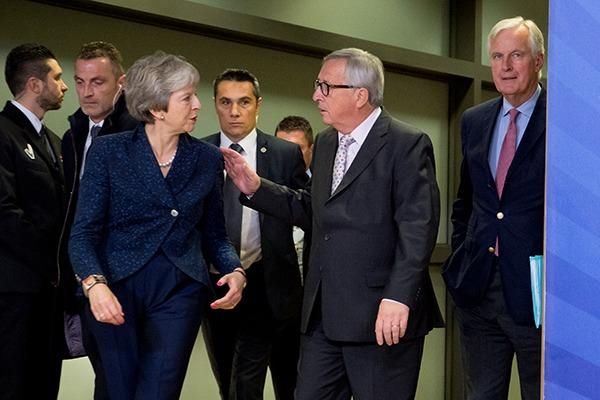 Theresa May, Jean-Claude Juncker and Michel Barnier