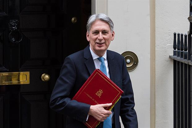 Philip Hammond on his way to delivery the Spring Statement. Photograph: WIktor Szymanowicz/NurPhoto via Getty Images