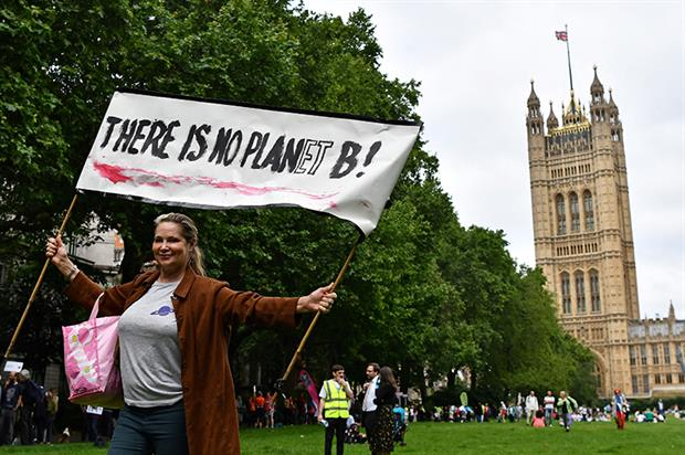 Climate protesters appearing at a 'mass lobby' of parliament organised by Greener UK and the Climate Coalition. Photograph: Ben Stansall/AFP/Getty Images
