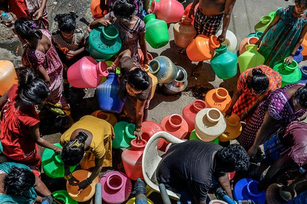 Chennai, India, 29 June 2019: People living in a slum settlement gather near a water tanker to collect their daily supply (photograph: Atul Loke/Getty Images)