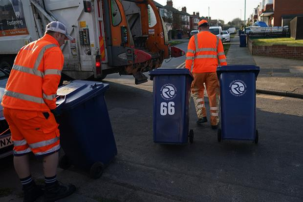 Refuse collection teams continue to work as normal as the UK adjusts to life under the coronavirus pandemic. Photograph: Ian Forsyth/Getty Images