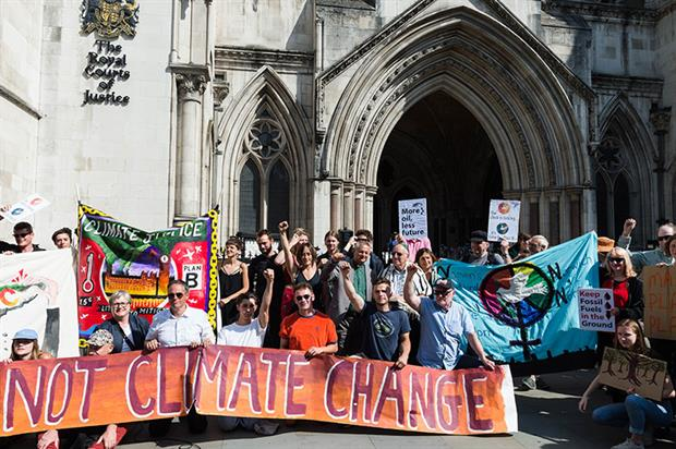 Campaigners outside the Royal Courts of Justice during the judicial review of the government's Heathrow expansion policy. Photograph: Wiktor Szymanowicz/Getty Images