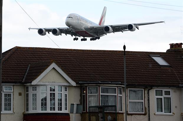 A plane flies over Myrtle Avenue, Hounslow: noise pollution is one of the big hurdles faced by Heathrow airport's expansion plans (James D. Morgan/Getty).