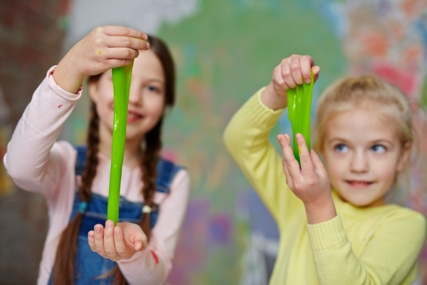 Girls playing with slime