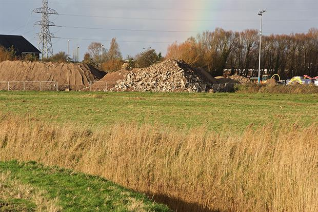 The site, which the EA says could cause a risk to human health, shares a boundary with a football pitch. Photograph: Derek Baxter