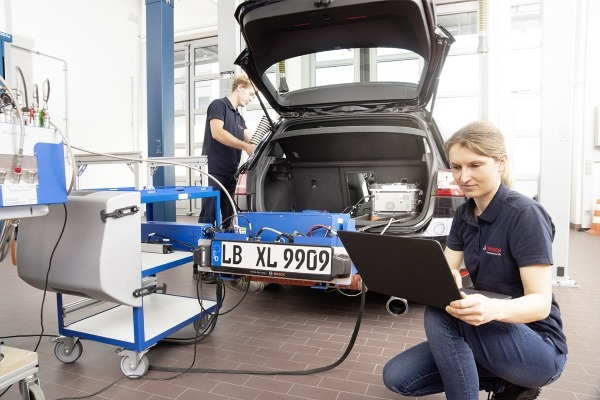 Bosch engineers check a car's emissions