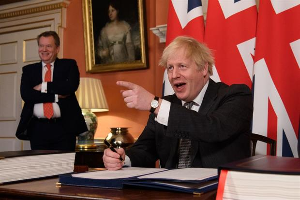 Prime minister Boris Johnson signs the UK-EU Trade and Cooperation Agreement on 30 December. Green groups are worried it does not contain sufficient protections for environmental standards. Photo: Leon Neal / POOL / AFP / Getty Images