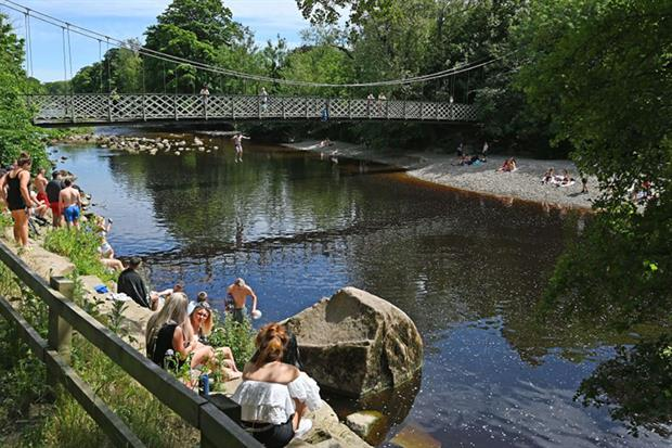 Bathers at the river Wharfe in Ilkley. (Photo by PAUL ELLIS/AFP via Getty Images)