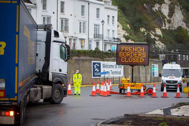 Currently, more than 1,500 lorries are stuck in Dover waiting to leave the UK. (photo by Andrew Aitchison / In pictures via Getty Images)