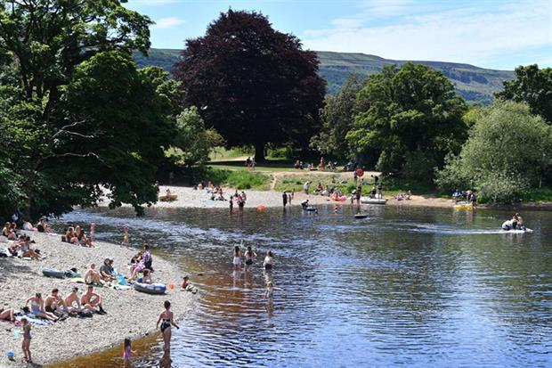 A part of Yorkshire's river Wharfe has been designated a bathing water following a campaign which claimed a 1km stretch popular for swimming is beset by sewage pollution (Photo by PAUL ELLIS/AFP via Getty Images)