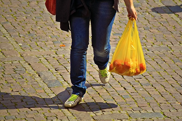 Shopper carrying plastic bag