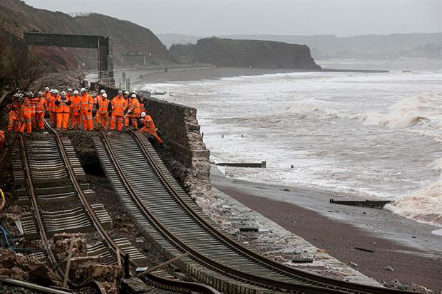 Railway workers inspect the main Exeter to Plymouth railway line that was closed due to parts of it being washed away by the sea at Dawlish on February 5, 2014 in Devon. Photograph: Matt Cardy/Getty Images