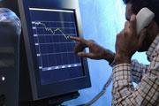 Man looking at computer trading screen