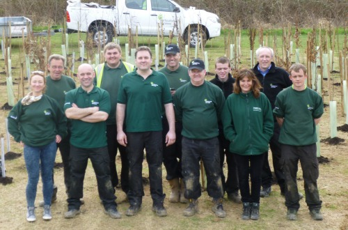 All smiles for the Sodexho team after planting 175 trees
