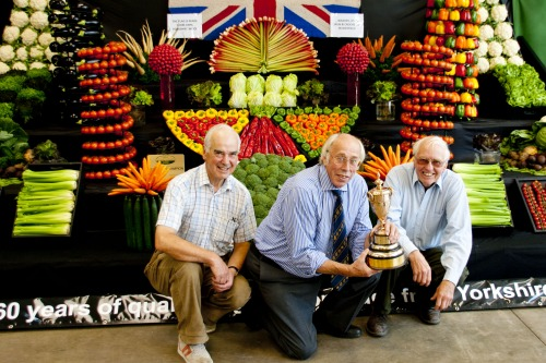 Graham Ward holds the show's Gold Cup, flanked by the team's John Watt and Mike Prest - image: NFU