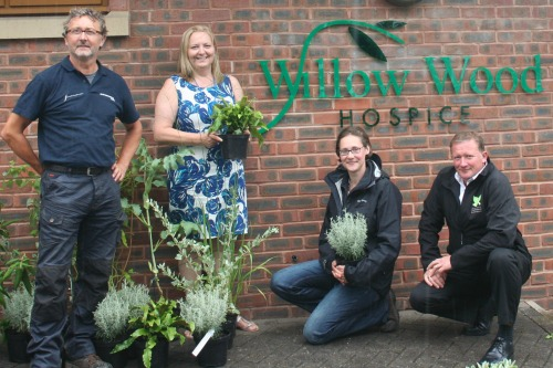 L-R is Steve Foxcroft,  Willow Wood chief executive Karen Houlston,  Sophie Cordingley and Andrew Dunkley