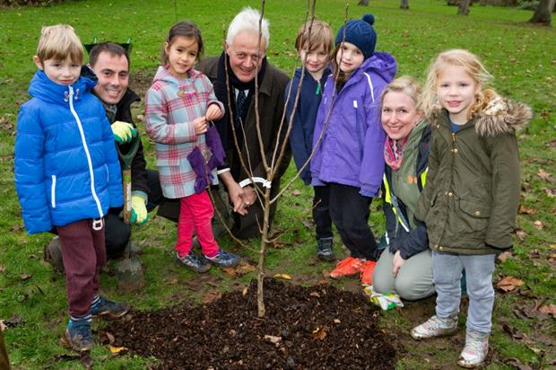 (Adults l - r) Matthew O'Conner, Duncan Wilson and Amber Alferoff of the London Orchard Project with children from Muswell Hill Primary. Picture: HW