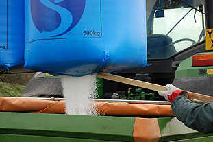 Preparing for broadcast: topping up the hopper safely with the knife on shaft. Image: GrowHow UK