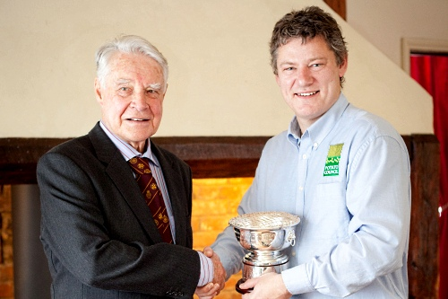 Dr Jack Dunnett accepts the British Potato Industry Award from Potato Council director Rob Clayton