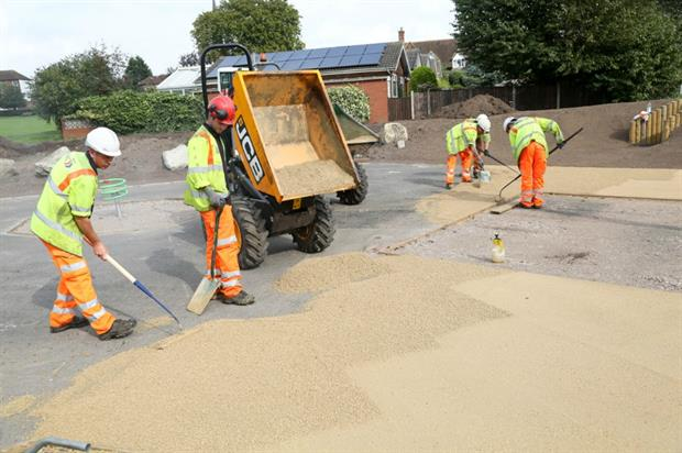 Contractors laying the new surface. Image: Bituchem