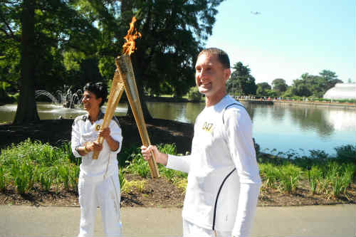 John Harding with the 2012 Olympic flame - image: Squires