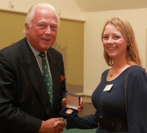 Alderman Gordon Haines presenting an award to one Epping Forest volunteer