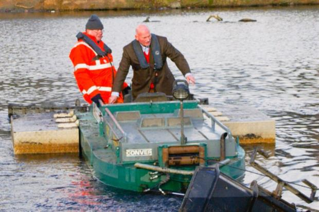 Councillor Wallace drives the dredger