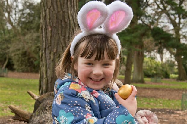 Young visitor Rosie enjoys the Easter egg trail. Image: RBGE