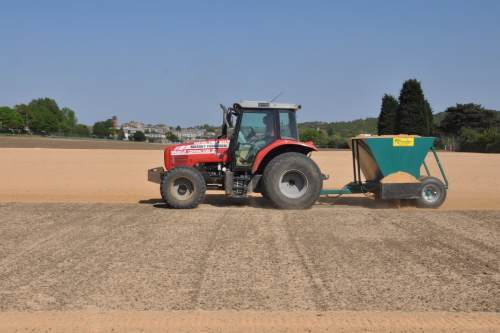 The scale of the Kidbrooke Playing Fields job can be seen in this shot of Speedcut applying sand prior to seeding - image: Speedcut