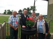 Anthony Andrews (left) donates the Elsner plants