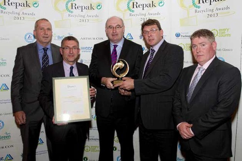 Irish environment minister Phil Hogan (centre) presents the award - image:Holfeld Plastics