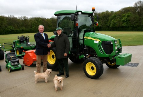 Sir Jackie Stewart with Farol groundcare sales manager Peter  Helps and Sir Jackie's dogs Whisky and Pimms