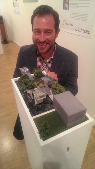 Jamie Dunstan with his design at the MiNiATURE show