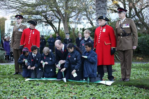 HRH the Duke of Cambridge planting poppies with local children