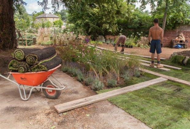 Laying the turf in the new garden. Picture: Q Lawns