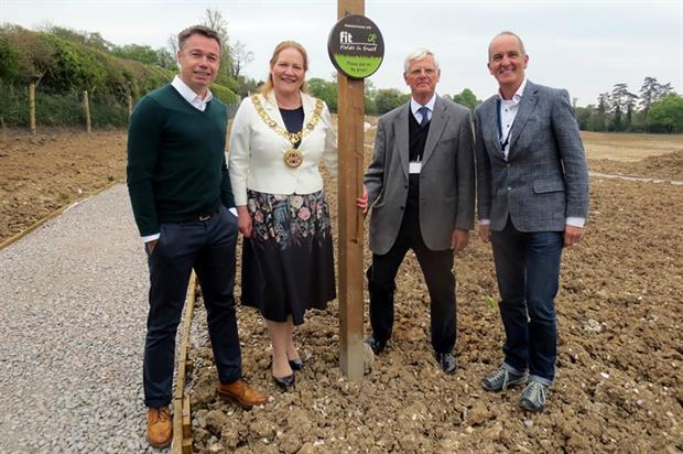 (l-r) Graeme Le Saux (left) and Kevin McCloud (right) join local politicians on site. Image: FIT