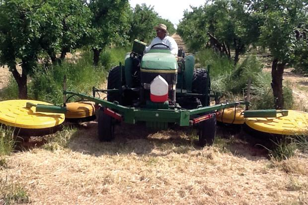 Reason Farms: Micron Spraydome units used for weed control in California orchards - image: Micron Group