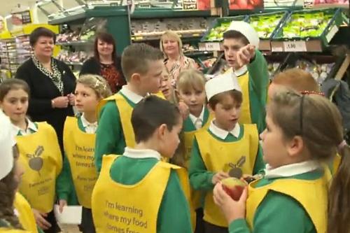 Schoolchildren visit a Tesco fresh produce department - image:Tesco