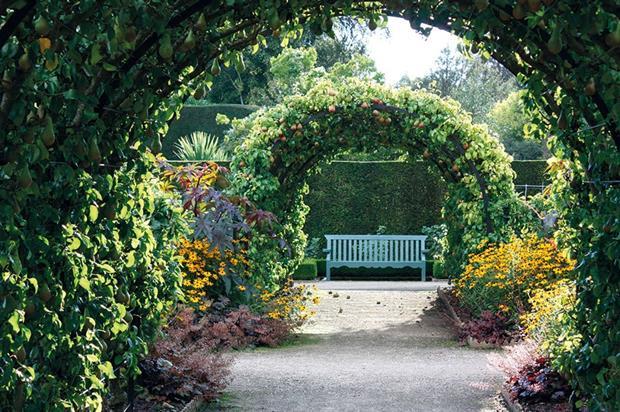West Dean Gardens' Pear Arch in the walled garden. Image: West Dean Gardens
