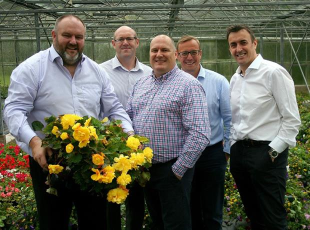 Plantscape managing director Mark Stone with Tony Cammiss, managing director of TCL, Nick Truesdale, director of TCL North, TCL Group CFO Simon Abley and Simon Cashmore, CEO of TCL Group.
